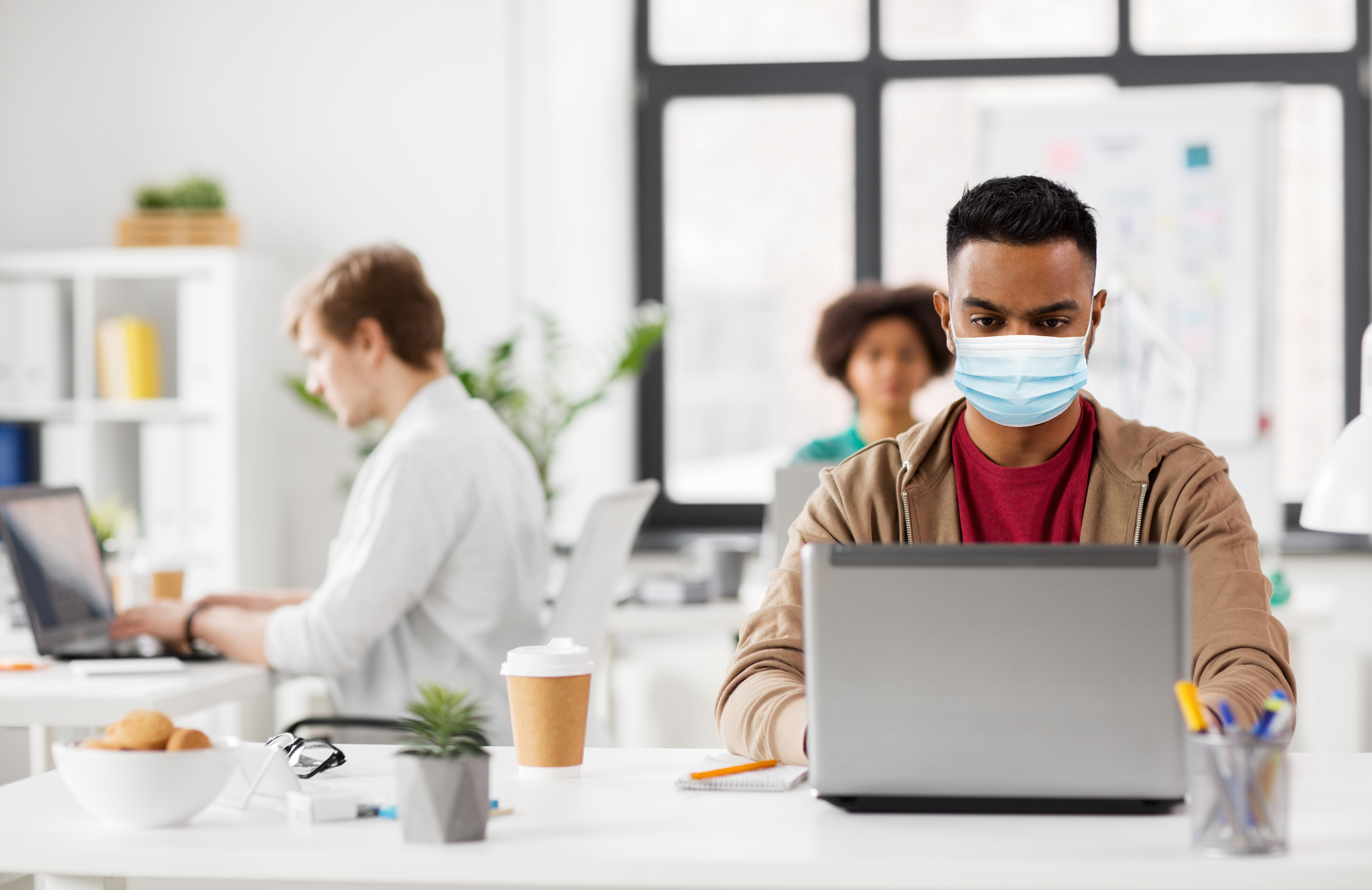 Indian Man With Laptop In Medical Mask At Office