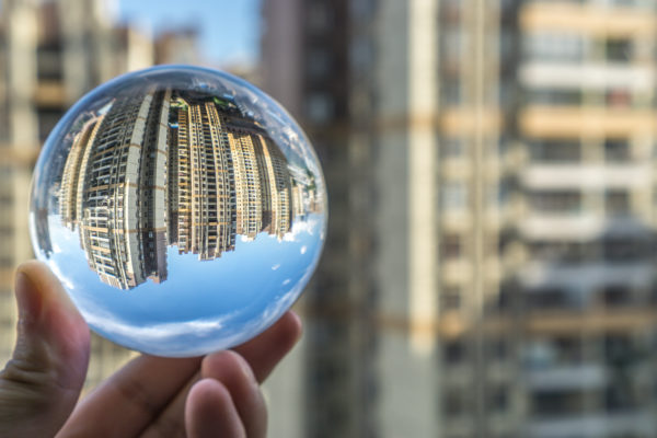 Round Glass Ball With Big City Buildings Background